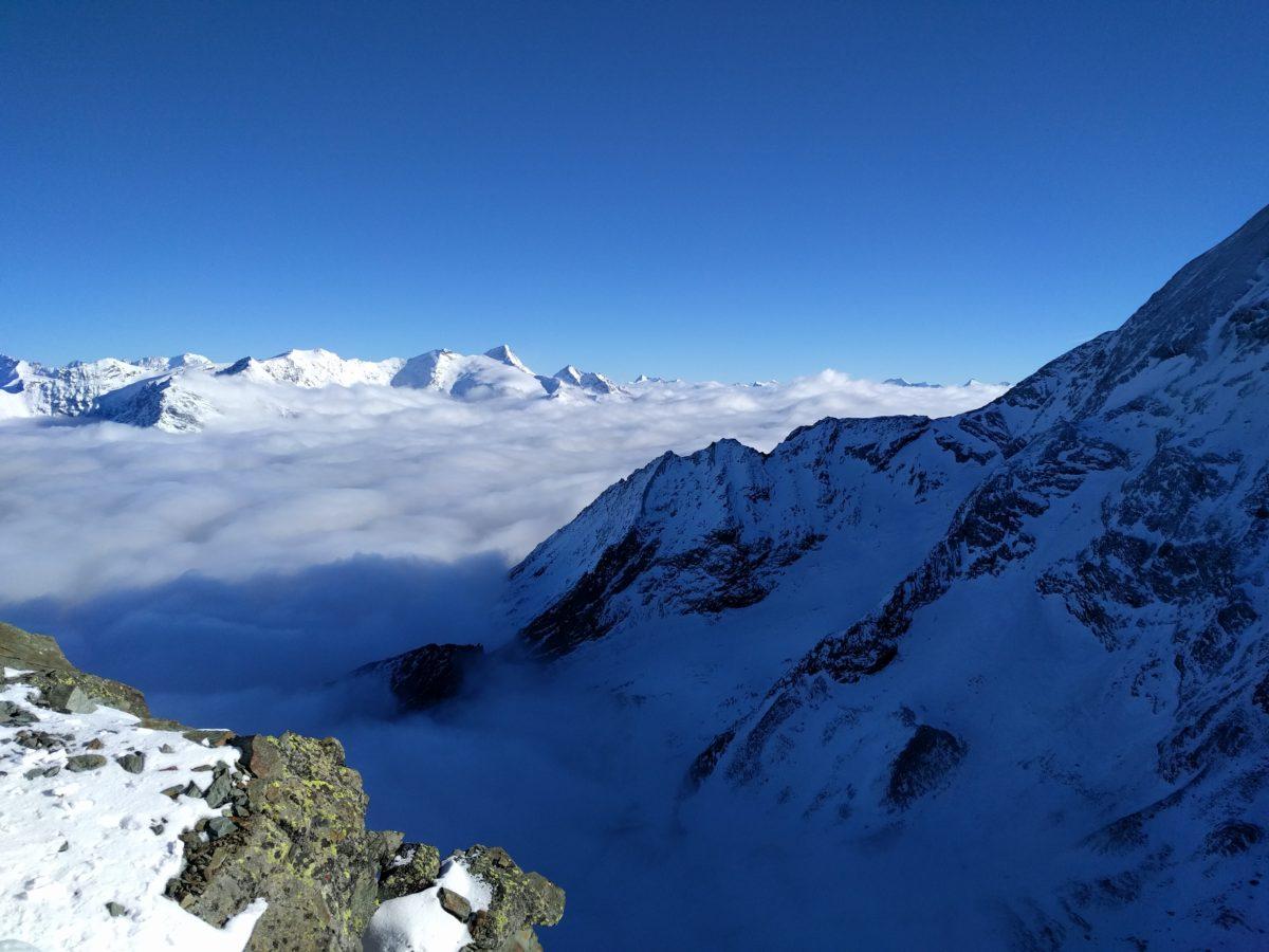 Mountain panorama above clouds