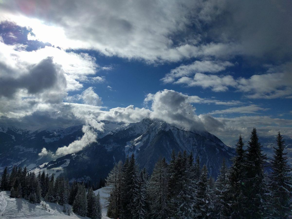 flachau mountains with clouds around peek
