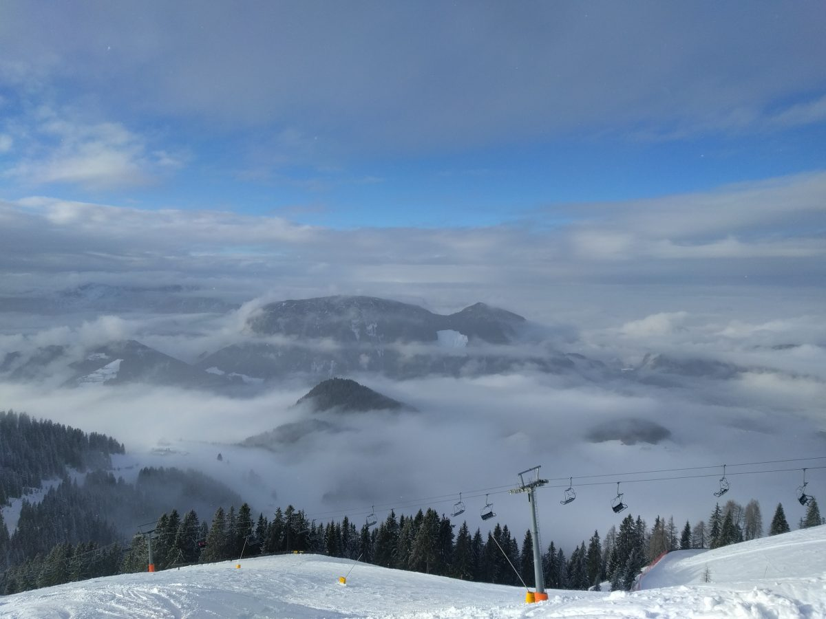ski lift and mountains in clouds