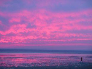 Tarifa sunset with walker on the beach