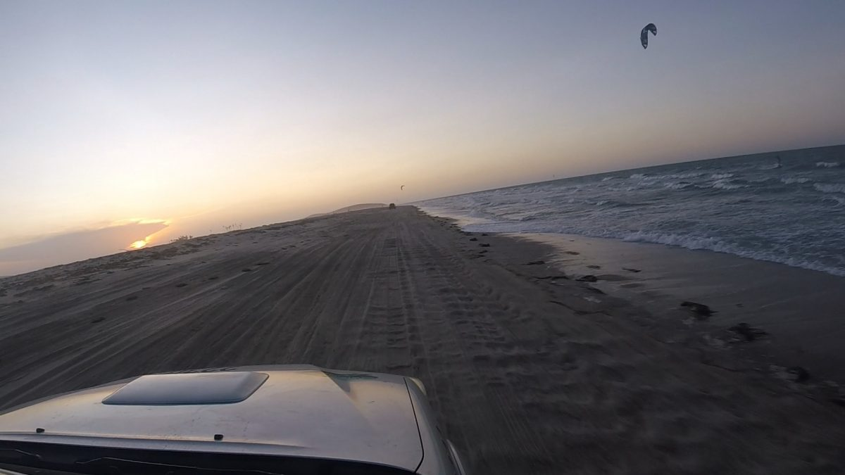 jeep beach ride with kitesurfer in sunset