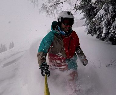 Skier in waist deep powder in Saalbach. Freeride Saalbach