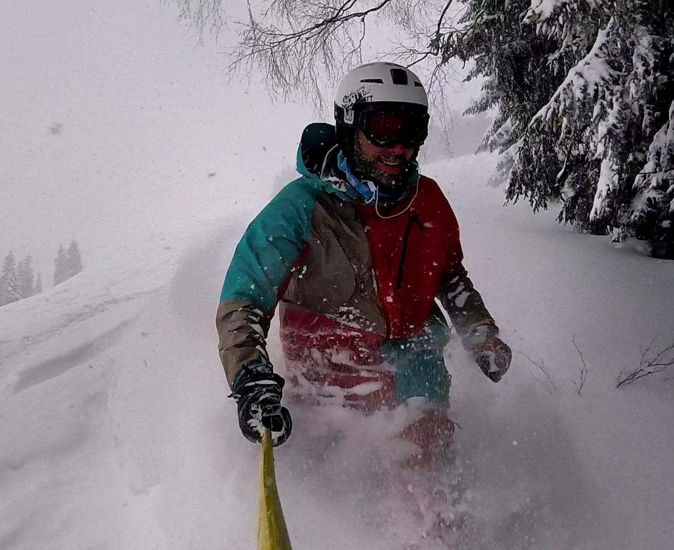 Skier in waist deep powder in Saalbach. Freeride Saalbach
