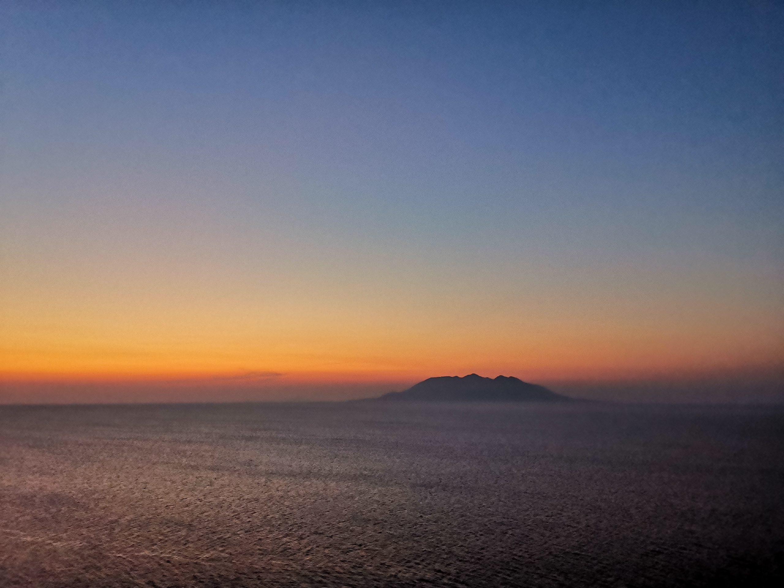 View to Greek island Samothrace from Poseidon Imroz restaurant